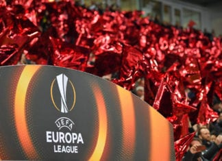 SALZBURG, AUSTRIA - MARCH 15: Red flags are seen behind the Europa League Logo prior to the UEFA Europa League Round of 16, 2nd leg match between FC Red Bull Salzburg and Borussia Dortmund at the Red Bull Arena on March 15, 2018 in Salzburg, Austria. (Photo by Sebastian Widmann/Bongarts/Getty Images,)