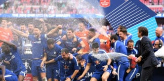 LONDON, ENGLAND - MAY 19: Antonio Conte, Manager of Chelsea sprays his team with Champagne following his sides victory in The Emirates FA Cup Final between Chelsea and Manchester United at Wembley Stadium on May 19, 2018 in London, England. (Photo by Laurence Griffiths/Getty Images)
