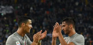UDINE, ITALY - OCTOBER 06: Cristiano Ronaldo and Rodrigo Bentancur of Juventus celebrate the victory afte the Serie A match between Udinese and Juventus at Stadio Friuli on October 6, 2018 in Udine, Italy. (Photo by Alessandro Sabattini/Getty Images)