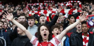 LONDON, ENGLAND - DECEMBER 02: Fans show their support during the Premier League match between Arsenal FC and Tottenham Hotspur at Emirates Stadium on December 1, 2018 in London, United Kingdom. (Photo by Julian Finney/Getty Images)