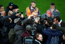 LIVERPOOL, ENGLAND - DECEMBER 10: Aurelio De Laurentiis, owner of Napoli is surrounded by media during a SSC Napoli training session ahead of their UEFA Champions League C match against Liverpool at Anfield on December 10, 2018 in Liverpool, England. (Photo by Clive Brunskill/Getty Images)