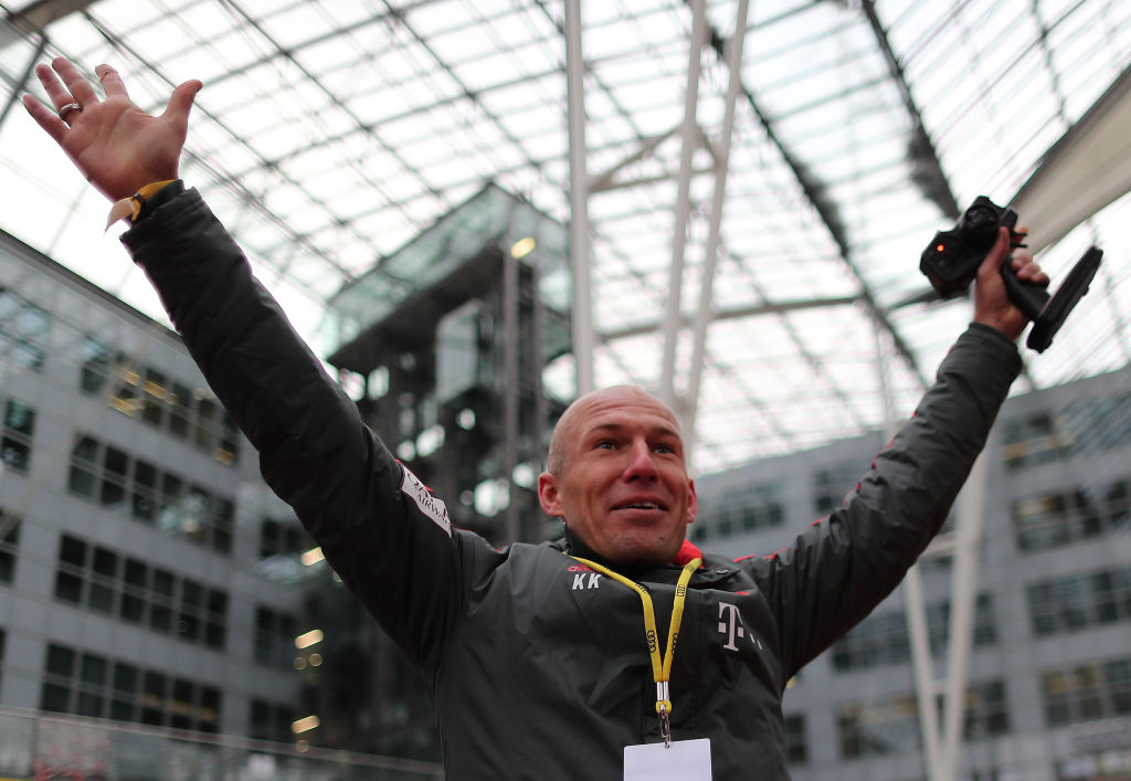 MUNICH, GERMANY - JANUARY 24: Arjen Robben of Bayern Muenchen raises his arms in celebration during a promotional event at Airport Munich on January 24, 2019 in Munich, Germany. FC Bayern meets Audi e-tron: FC Bayern was one of the first Audi partners to test drive the new Audi e-tron. (Photo by Christian Kaspar-Bartke/Getty Images for AUDI)