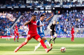 BARCELONA, SPAIN - MARCH 17: Wu Lei of RCD Espanyol and Gabriel Mercado of Sevilla FC compete for the ball during the La Liga match between RCD Espanyol and Sevilla FC at RCDE Stadium on March 17, 2019 in Barcelona, Spain. (Photo by Alex Caparros/Getty Images)