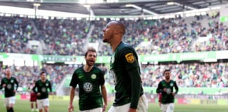 WOLFSBURG, GERMANY - MAY 04: Marcel Tisserand (C) of Wolfsburg celebrates after scoring the 2-1 lead during the Bundesliga match between VfL Wolfsburg and 1. FC Nuernberg at Volkswagen Arena on May 4, 2019 in Wolfsburg, Germany. (Photo by Ronny Hartmann/Bongarts/Getty Images)