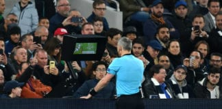 LONDON, ENGLAND - APRIL 09: Referee Bjorn Kuipers checks the VAR after a handball incident by Danny Rose of Tottenham Hotspur (not pictured) during the UEFA Champions League Quarter Final first leg match between Tottenham Hotspur and Manchester City at Tottenham Hotspur Stadium on April 09, 2019 in London, England. (Photo by Dan Mullan/Getty Images)