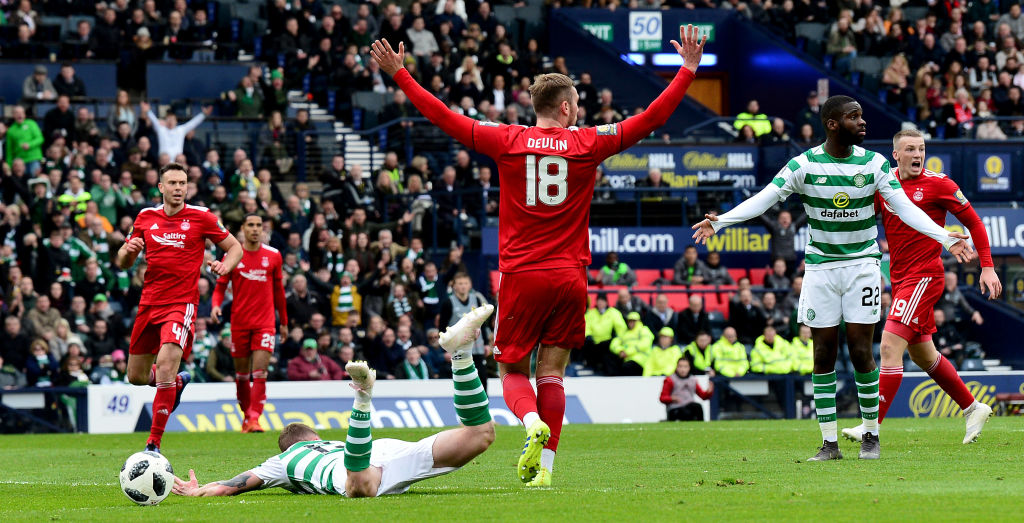 GLASGOW, SCOTLAND - APRIL 14: Jonathan Hayes of Celtic is fouled by Mikey Devlin of Aberdeen during the Scottish Cup semi-final between Aberdeen and Celtic at Hampden Park on April 14, 2019 in Glasgow, Scotland. (Photo by Mark Runnacles/Getty Images)
