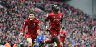 LIVERPOOL, ENGLAND - APRIL 14: Sadio Mane of Liverpool celebrates after scoring his team's first goal with Andy Robertson during the Premier League match between Liverpool FC and Chelsea FC at Anfield on April 14, 2019 in Liverpool, United Kingdom. (Photo by Michael Regan/Getty Images)