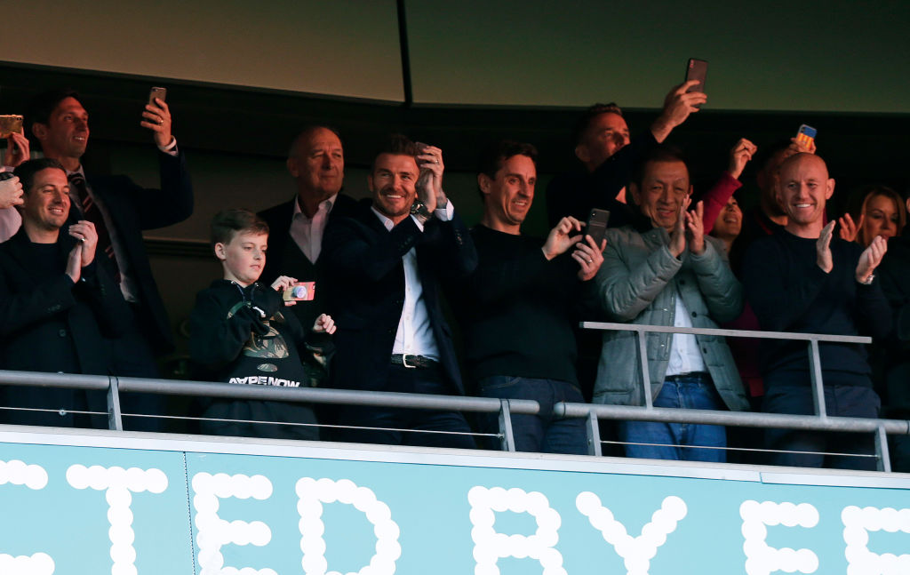 LONDON, ENGLAND - MAY 11: David Beckham and Gary Neville in the stands during the Vanarama National League Play Off Final between Salford City and AFC Fylde at Wembley Stadium on May 11, 2019 in London, England. (Photo by Henry Browne/Getty Images)