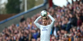 BURNLEY, ENGLAND - APRIL 13: Joe Bennett of Cardiff City takes a throw in during the Premier League match between Burnley FC and Cardiff City at Turf Moor on April 13, 2019 in Burnley, United Kingdom. (Photo by Alex Livesey/Getty Images)