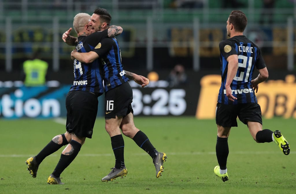 MILAN, ITALY - MAY 13: Matteo Politano of FC Internazionale celebrates with his team-mate Radja Nainggolan (L) after scoring the opening goal during the Serie A match between FC Internazionale and Chievo at Stadio Giuseppe Meazza on May 13, 2019 in Milan, Italy. (Photo by Emilio Andreoli/Getty Images)