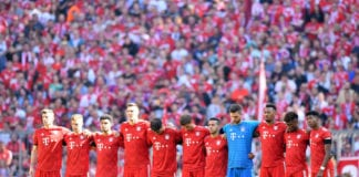 MUNICH, GERMANY - APRIL 20: Bayern Munich players observe a minutes silence prior to the Bundesliga match between FC Bayern Muenchen and SV Werder Bremen at Allianz Arena on April 20, 2019 in Munich, Germany. (Photo by Sebastian Widmann/Bongarts/Getty Images)