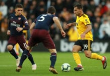 WOLVERHAMPTON, ENGLAND - APRIL 24: Jonny Otto of Wolverhampton Wanderers runs with the ball under pressure from Sokratis Papastathopoulos and Lucas Torreira of Arsenal during the Premier League match between Wolverhampton Wanderers and Arsenal FC at Molineux on April 24, 2019 in Wolverhampton, United Kingdom. (Photo by David Rogers/Getty Images)