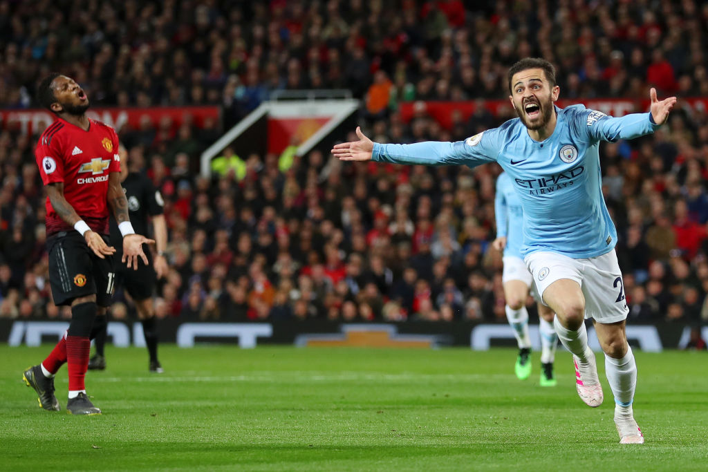 MANCHESTER, ENGLAND - APRIL 24: Bernardo Silva of Manchester City celebrates after scoring his team's first goal as Fred of Manchester United reacts during the Premier League match between Manchester United and Manchester City at Old Trafford on April 24, 2019 in Manchester, United Kingdom. (Photo by Catherine Ivill/Getty Images)