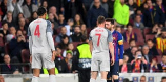 BARCELONA, SPAIN - MAY 01: James Milner of Liverpool argues with Lionel Messi of Barcelona after a challenge during the UEFA Champions League Semi Final first leg match between Barcelona and Liverpool at the Nou Camp on May 01, 2019 in Barcelona, Spain. (Photo by Michael Regan/Getty Images)