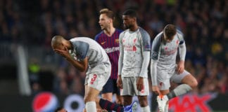 BARCELONA, SPAIN - MAY 01: Fabinho of Liverpool reacts after he challenges Sergio Busquets of Barcelona during the UEFA Champions League Semi Final first leg match between Barcelona and Liverpool at the Nou Camp on May 01, 2019 in Barcelona, Spain. (Photo by Catherine Ivill/Getty Images)