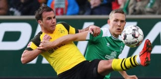 BREMEN, GERMANY - MAY 04: Ludwig Augustinsson (R) of SV Werder Bremen challenges for the ball with Mario Goetze (L) of Borussia Dortmund during the Bundesliga match between SV Werder Bremen and Borussia Dortmund at Weserstadion on May 04, 2019 in Bremen, Germany. (Photo by Oliver Hardt/Bongarts/Getty Images)