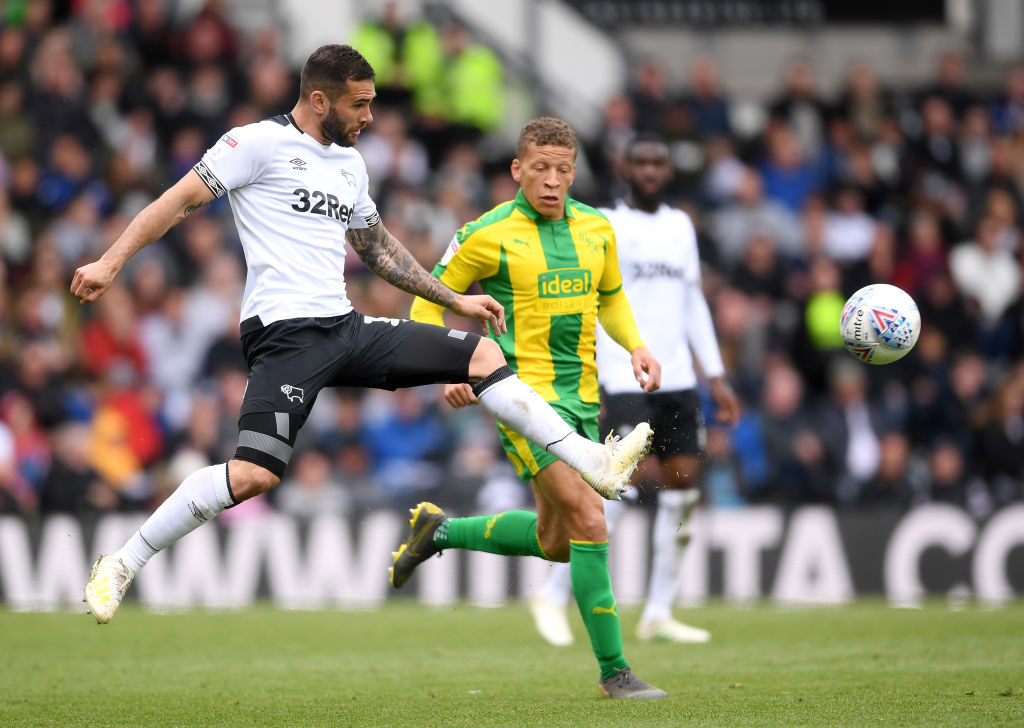 DERBY, ENGLAND - MAY 05: Bradley Johnson of Derby Countyc lears from Dwight Gayle of West Bromwich Albion during the Sky Bet Championship match between Derby County and West Bromwich Albion at Pride Park Stadium on May 05, 2019 in Derby, England. (Photo by Laurence Griffiths/Getty Images)