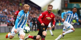 HUDDERSFIELD, ENGLAND - MAY 05: Alex Pritchard of Huddersfield Town is chased by Luke Shaw of Manchester United during the Premier League match between Huddersfield Town and Manchester United at John Smith's Stadium on May 05, 2019 in Huddersfield, United Kingdom. (Photo by Clive Brunskill/Getty Images)