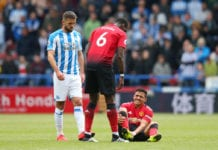 HUDDERSFIELD, ENGLAND - MAY 05: An injured Alexis Sanchez of Manchester United is spoken to by team mate Paul Pogba during the Premier League match between Huddersfield Town and Manchester United at John Smith's Stadium on May 05, 2019 in Huddersfield, United Kingdom. (Photo by Alex Livesey/Getty Images)