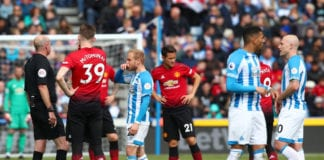 HUDDERSFIELD, ENGLAND - MAY 05: Players are made to wait as a corner flag had to be replaced during the Premier League match between Huddersfield Town and Manchester United at John Smith's Stadium on May 05, 2019 in Huddersfield, United Kingdom. (Photo by Clive Brunskill/Getty Images)