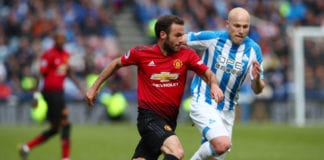 HUDDERSFIELD, ENGLAND - MAY 05: Juan Mata of Manchester United is chased by Aaron Mooy of Huddersfield Town during the Premier League match between Huddersfield Town and Manchester United at John Smith's Stadium on May 05, 2019 in Huddersfield, United Kingdom. (Photo by Clive Brunskill/Getty Images)