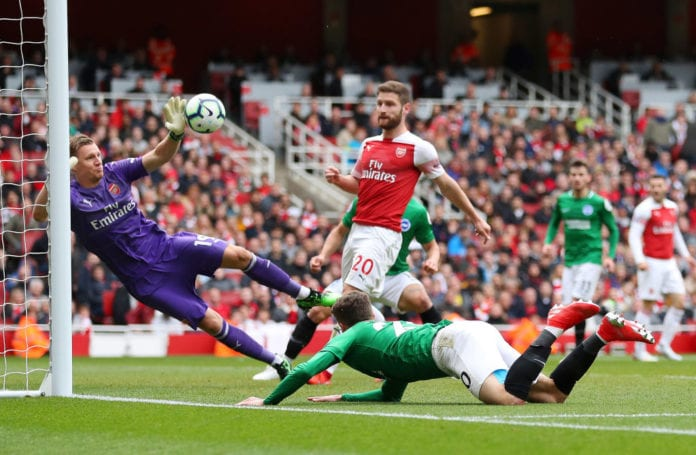 LONDON, ENGLAND - MAY 05: Bernd Leno of Arsenal saves the ball from Solomon March of Brighton and Hove Albion during the Premier League match between Arsenal FC and Brighton & Hove Albion at Emirates Stadium on May 05, 2019 in London, United Kingdom. (Photo by Catherine Ivill/Getty Images)