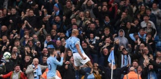 MANCHESTER, ENGLAND - MAY 06: Vincent Kompany of Manchester City celebrates after scoring his team's first goal with Bernardo Silva of Manchester City during the Premier League match between Manchester City and Leicester City at Etihad Stadium on May 06, 2019 in Manchester, United Kingdom. (Photo by Laurence Griffiths/Getty Images)