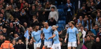 MANCHESTER, ENGLAND - MAY 06: Vincent Kompany of Manchester City celebrates after scoring his team's first goal with Raheem Sterling of Manchester City and Sergio Aguero of Manchester City during the Premier League match between Manchester City and Leicester City at Etihad Stadium on May 06, 2019 in Manchester, United Kingdom. (Photo by Laurence Griffiths/Getty Images)