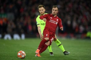 LIVERPOOL, ENGLAND - MAY 07: Xherdan Shaqiri of Liverpool is watched by Ivan Rakitic of Barcelona during the UEFA Champions League Semi Final second leg match between Liverpool and Barcelona at Anfield on May 07, 2019 in Liverpool, England. (Photo by Shaun Botterill/Getty Images)