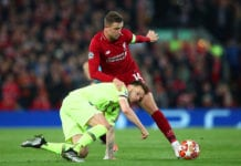 LIVERPOOL, ENGLAND - MAY 07: Ivan Rakitic of Barcelona battles with Jordan Henderson of Liverpool during the UEFA Champions League Semi Final second leg match between Liverpool and Barcelona at Anfield on May 07, 2019 in Liverpool, England. (Photo by Clive Brunskill/Getty Images)
