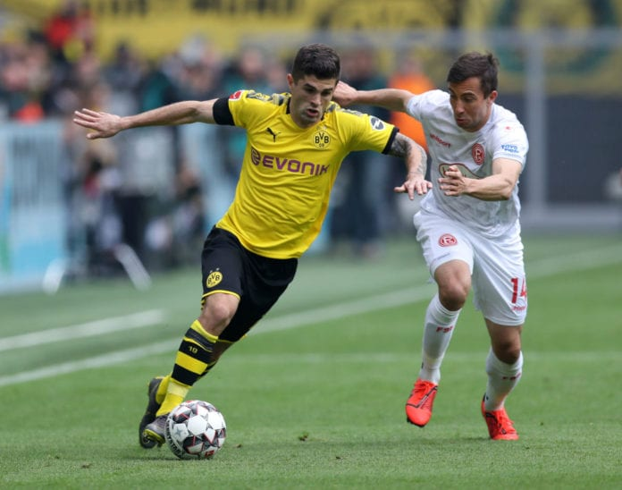 DORTMUND, GERMANY - MAY 11: Christian Pulisic of Borussia Dortmund battles for possession with Markus Suttner of Fortuna Duesseldorf during the Bundesliga match between Borussia Dortmund and Fortuna Duesseldorf at Signal Iduna Park on May 11, 2019 in Dortmund, Germany. (Photo by Maja Hitij/Bongarts/Getty Images)