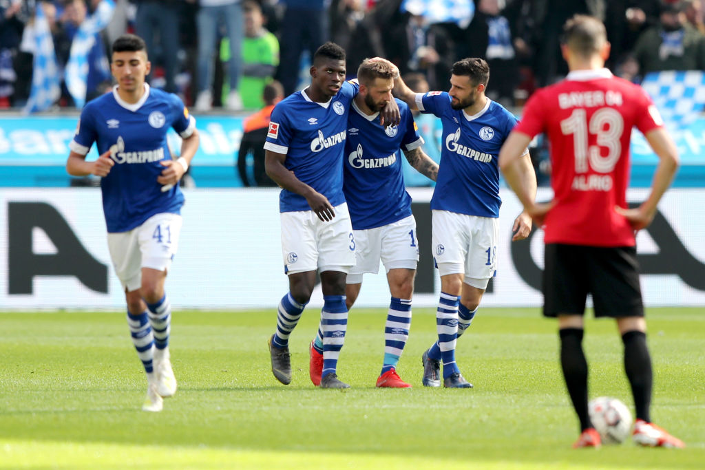 LEVERKUSEN, GERMANY - MAY 11: Guido Burgstaller of FC Schalke 04 celebrates with teammates Breel Embolo and Daniel Caligiuri after scoring his team's first goal during the Bundesliga match between Bayer 04 Leverkusen and FC Schalke 04 at BayArena on May 11, 2019 in Leverkusen, Germany. (Photo by Christof Koepsel/Bongarts/Getty Images)
