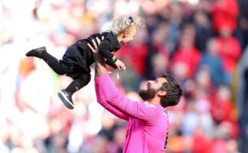 LIVERPOOL, ENGLAND - MAY 12: Alisson of Liverpool holds his child up in the air after the Premier League match between Liverpool FC and Wolverhampton Wanderers at Anfield on May 12, 2019 in Liverpool, United Kingdom. (Photo by Catherine Ivill/Getty Images)