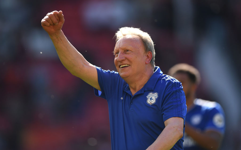 MANCHESTER, ENGLAND - MAY 12: Cardiff manager Neil Warnock celebrates with the fans after the Premier League match between Manchester United and Cardiff City at Old Trafford on May 12, 2019 in Manchester, United Kingdom. (Photo by Stu Forster/Getty Images)