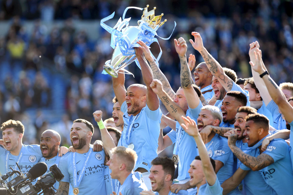BRIGHTON, ENGLAND - MAY 12: Vincent Kompany of Manchester City lifts the Premier League Trophy after winning the title during the Premier League match between Brighton & Hove Albion and Manchester City at American Express Community Stadium on May 12, 2019 in Brighton, United Kingdom. (Photo by Shaun Botterill/Getty Images)