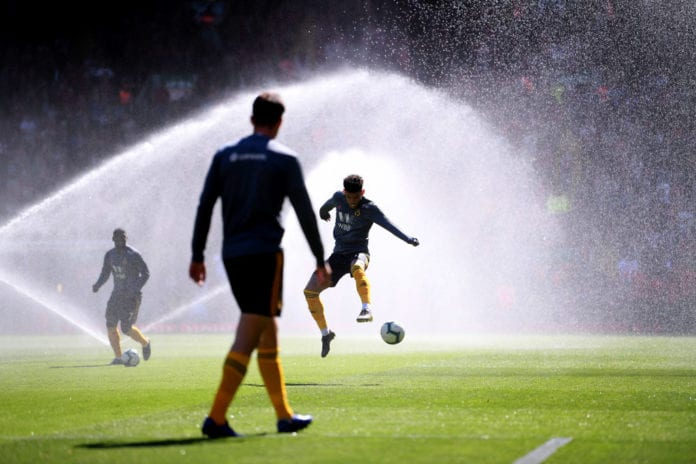 LIVERPOOL, ENGLAND - MAY 12: Morgan Gibbs-Wright of Liverpool controls the ball in the sprinklers at half time during the Premier League match between Liverpool FC and Wolverhampton Wanderers at Anfield on May 12, 2019 in Liverpool, United Kingdom. (Photo by Laurence Griffiths/Getty Images)