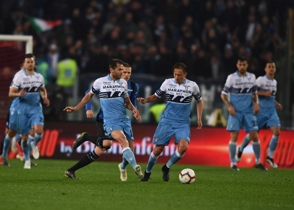 ROME, ITALY - MAY 15: Senad Lulic and Lucas Leiva of SS Lazio control the ball during the TIM Cup Final match between Atalanta BC and SS Lazio at Stadio Olimpico on May 15, 2019 in Rome, Italy. (Photo by Claudio Villa/Getty Images for Lega Serie A)