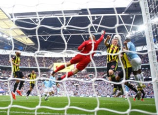 LONDON, ENGLAND - MAY 18: Heurelho Gomes and Will Hughes of Watford jump for the ball during the FA Cup Final match between Manchester City and Watford at Wembley Stadium on May 18, 2019 in London, England. (Photo by Richard Heathcote/Getty Images)