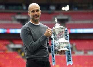 LONDON, ENGLAND - MAY 18: Josep Guardiola, Manager of Manchester City stops for a photograph with the trophy following victory in the FA Cup Final match between Manchester City and Watford at Wembley Stadium on May 18, 2019 in London, England. (Photo by Julian Finney/Getty Images)