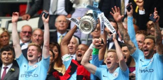 LONDON, ENGLAND - MAY 18: Vincent Kompany of Manchester City lifts the trophy following the FA Cup Final match between Manchester City and Watford at Wembley Stadium on May 18, 2019 in London, England. (Photo by Julian Finney/Getty Images)