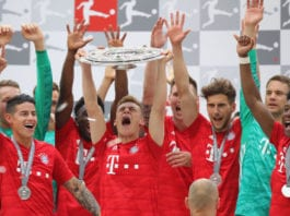 MUNICH, GERMANY - MAY 18: Joshua Kimmich of Bayern Munich lifts the trophy following the Bundesliga match between FC Bayern Muenchen and Eintracht Frankfurt at Allianz Arena on May 18, 2019 in Munich, Germany. (Photo by Alexander Hassenstein/Bongarts/Getty Images)