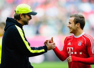 MUNICH, GERMANY - APRIL 12: Mario Goetze (R) of Muenchen and Juergen Klopp, head coach of Dortmund shake hands prior to the Bundesliga match between FC Bayern Muenchen and Borussia Dortmund at Allianz Arena on April 12, 2014 in Munich, Germany. (Photo by Lennart Preiss/Bongarts/Getty Images)