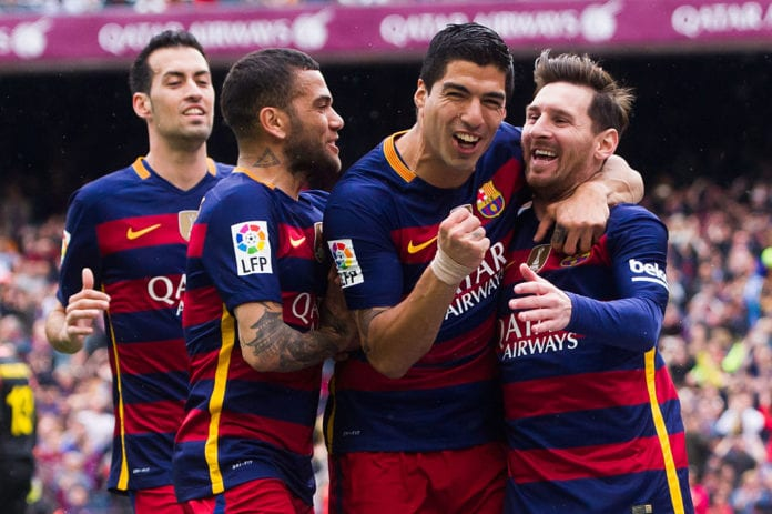 BARCELONA, SPAIN - MAY 08: (L-R) Sergio Busquets, Dani Alves and Luis Suarez celebrate with their teammate Lionel Messi after scoring the opening goal during the La Liga match between FC Barcelona and RCD Espanyol at Camp Nou on May 8, 2016 in Barcelona, Spain. (Photo by Alex Caparros/Getty Images)