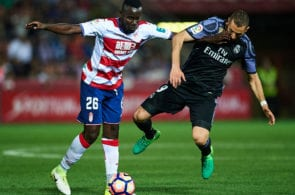 GRANADA, SPAIN - MAY 06: Victorien Angban of Granada CF (L) competes for the ball with Karim Benzema of Real Madrid CF (R) during the La Liga match between Granada CF v Real Madrid CF at Estadio Nuevo Los Carmenes on May 6, 2017 in Granada, Spain. (Photo by Aitor Alcalde/Getty Images)
