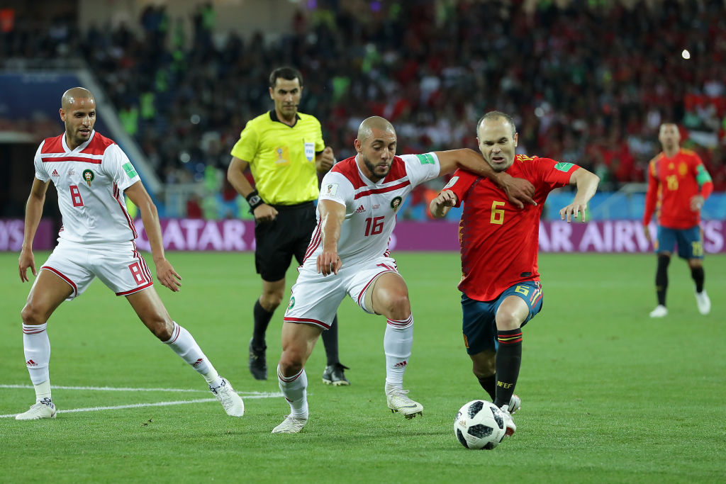 KALININGRAD, RUSSIA - JUNE 25: Noureddine Amrabat of Morocco battles with Andres Iniesta of Spain during the 2018 FIFA World Cup Russia group B match between Spain and Morocco at Kaliningrad Stadium on June 25, 2018 in Kaliningrad, Russia. (Photo by Richard Heathcote/Getty Images)
