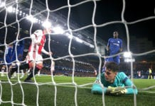 Kepa Arrizabalaga watches in dismay after his 35th minute own goal